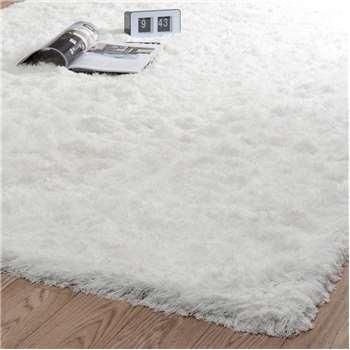 INUIT fabric long pile rug in ecru (140 x 200cm)